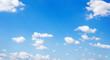 Leinwandbild Motiv Blue sky background and white clouds soft focus, and copy space