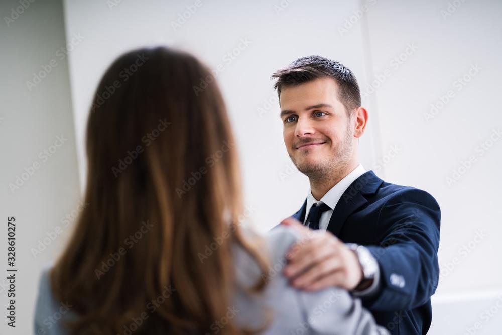 Fototapeta Businessman Congratulating Success Of Female Colleague