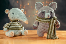 Anteater And Raccoon Made In Crochet Amigurumi Technique With The Predominant Gray And Green Colors