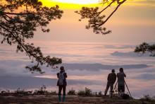 People With Sea Of Mist On Sun...