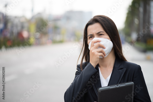 Close up of a businesswoman in a suit wearing Protective face mask and cough, get ready for Coronavirus and pm 2 Wallpaper Mural