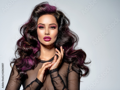 Fotografiet Portrait of beautiful young woman with bright maroon makeup