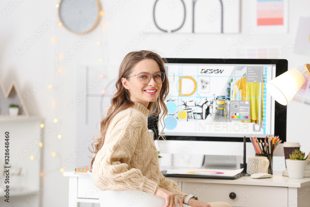 Fototapeta Female interior designer working in office
