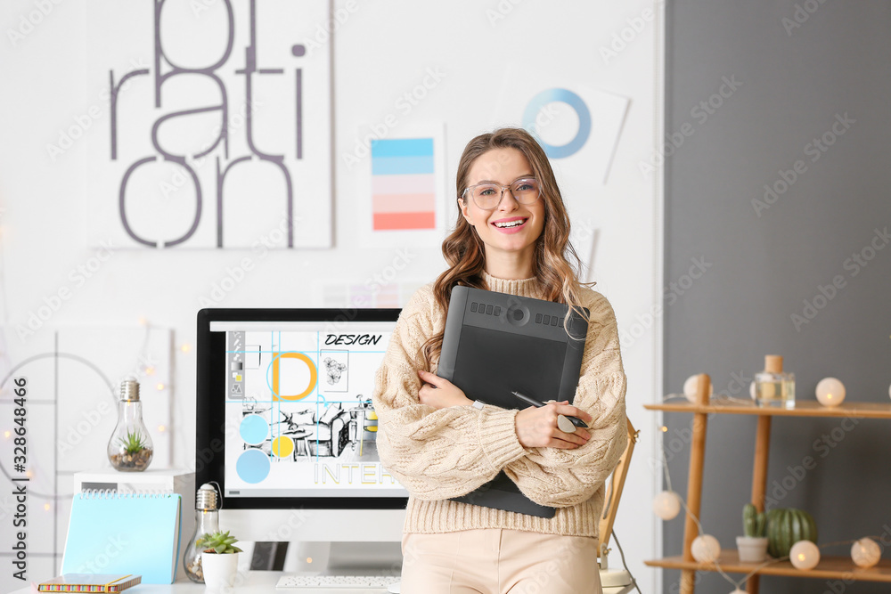 Fototapeta Portrait of female interior designer in office