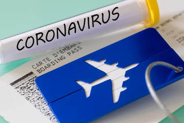 Coronavirus.  Laboratory vial, boarding pass and luggage tag. Concept of Airline financial problems due to the virus