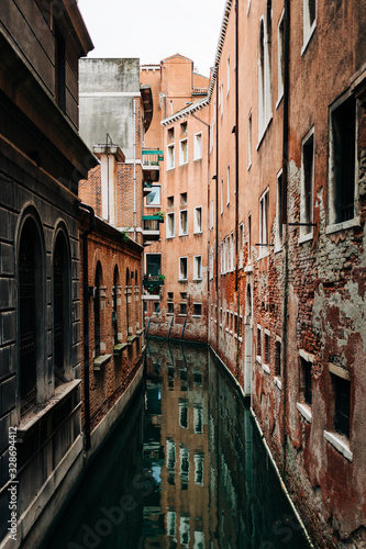 View of the rustic architecture of Venice, Italy canal alley  © marjan4782