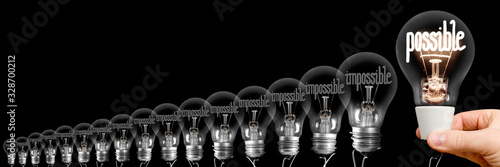 Obraz Light Bulbs with Possible and Impossible Concept - fototapety do salonu