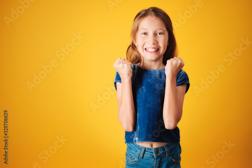 Photo Little Redhead Girl Jumping For Joy And Happiness