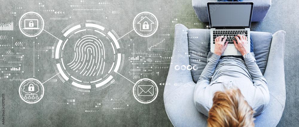 Fototapeta Fingerprint scanning theme with man using a laptop in a modern gray chair