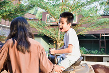 Kids With Special Needs Are Riding With A Close Supervision Teacher..This Is A Treatment Called Hippo Therapy. Happy Disabled Child Concept.