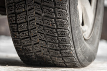 Car Tire With Winter Tires On Snow With Icicles
