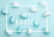 Easter background with Easter eggs in bird nest on blue background