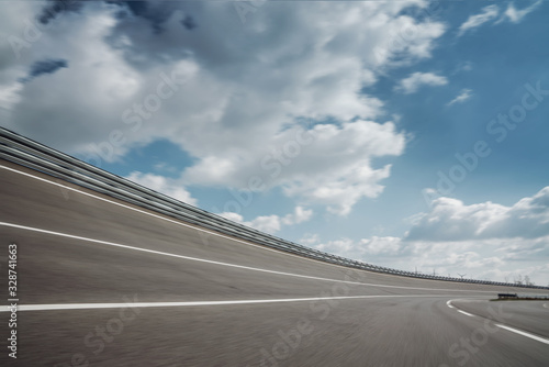 fototapeta na szkło Race Car / motorcycle racetrack on a sunny day.