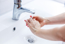 Woman Washing Her Hands With S...