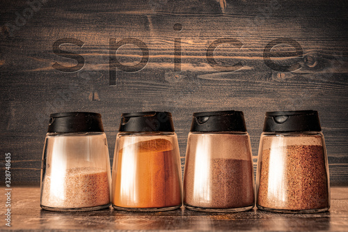 Cooking base kitchen concept - Set of spice shakers - Powder spices in jars on w Wallpaper Mural