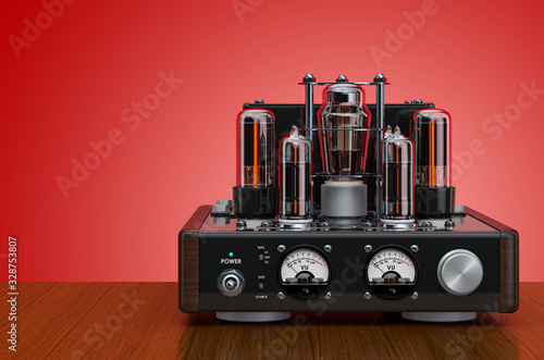 Retro vacuum tube amplifier on the wooden table. 3D rendering Canvas Print
