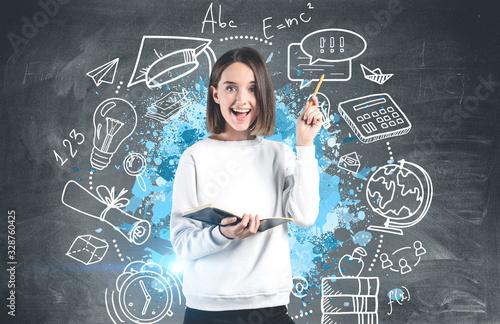Obraz Happy teen girl with notebook, education sketch - fototapety do salonu