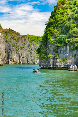 Halong bay islands. Tourist attraction, spectacular limestone grottos natural cave formations. Karst landforms in the sea, the world natural heritage. Beautiful azure water of the lagoon. Boat sail
