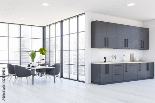 Obraz Panoramic white kitchen and dining room - fototapety do salonu