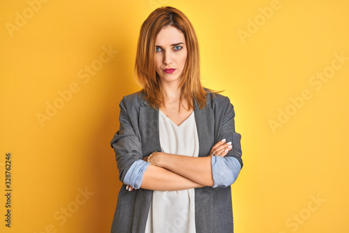 Redhead caucasian business woman over yellow isolated background shouting suffocate because painful strangle Wallpaper Mural