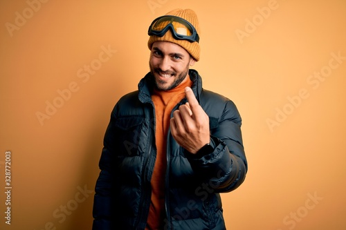 Young handsome skier man with beard wearing snow sportswear and ski goggles Beck Wallpaper Mural