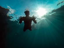 Underwater Photo Of Men Snorke...