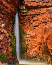 Deer Creek Falls In The Grand Canyon.  Over 100 Feet Tall And Visble From The Colordo River.  The Hike Above Leads To The Patio, Dutton Spring, And Thunder River. Grand Canyon National Park, Arizona