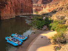 Colordo River Trip Stopped At Beach Of South Canyon.  Two Blue Rafts On The River's Edge With Ropes In The Sand.  Redwall Limestone Of Marble Canyon In The Grand Canyon National Park, Arizona