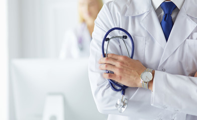 Young and confident male doctor with stethoscope in his hands. Successful doctor career concept