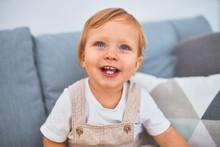Adorable Blonde Toddler Sittin...