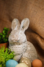 A Weathered Gray Rabbit Statue...