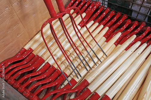 Obraz na plátně Steel forks piled up in the workshop
