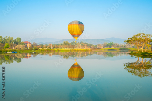 View of hot air balloons reflection on the lake in Singha park, Chiang Rai Canvas Print