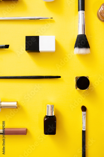 Set of make up accessories on yellow background. Cosmetics flat lay  knolling.