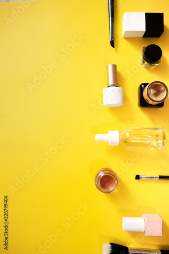make up flat lay on yellow background . web banner cosmetics porduct