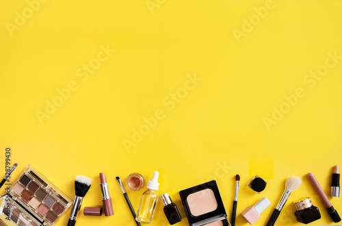 Make up flat lay on yellow background