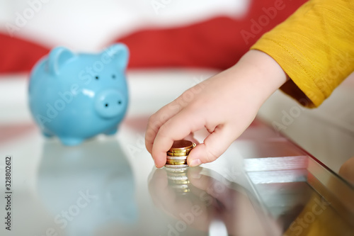 Little boy playing with coins and dreams of what he can buy Canvas Print