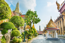 View Of Inner Court Of Temple Of Emerald Buddha With Ornate Buildings And Trees. Grand Palace Complex, Bangkok, Thailand