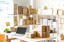 Equipments For SME Online Business , Delivery Business Laptop, Barcode, Boxes, Checking Product On Stocks Or Parcels. Small Business Working At Home Office.