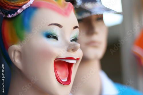 Laughing and smiling woman figurine in clothing store, good mood Canvas Print