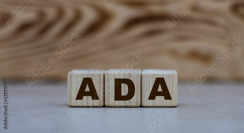 concept of the word ADA on cubes on a gray background with letters Wallpaper Mural