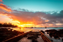 Sunset On Beach In Mauritius. ...