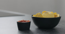 Serve Corn Chips With Salsa On Concrete Surface