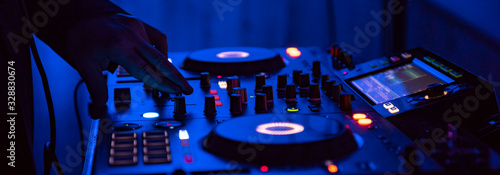 DJ Spinning, Mixing, and Scratching in a Night Club. DJ playing music at mixer . Closeup. Party. - 328830674