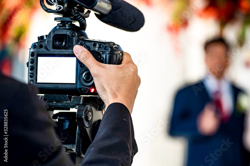 Female Videographer in backside are shooing and recording video in Wedding Event Canvas Print