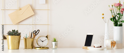 Stylish desk interior with White table background with plant and leaves Fototapete
