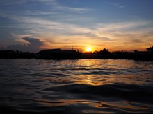 Sunset From A River Over Fishi...