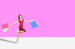 canvas print picture -  happy young womanl holding shopping bags  and running