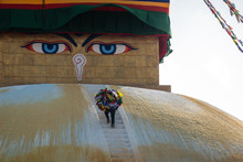 Man Climbing The Face Of The B...