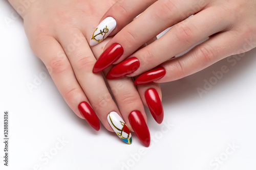 Red manicure on sharp long nails with painted anchors and umbrella on a white background Canvas Print